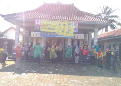 Penyemprotan Desinfektan di Fasilitas Umum Desa Beji